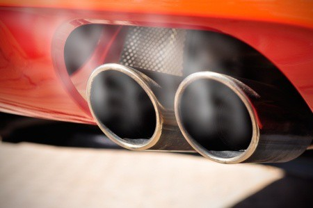 car dual exhaust pipe showing toxic gases